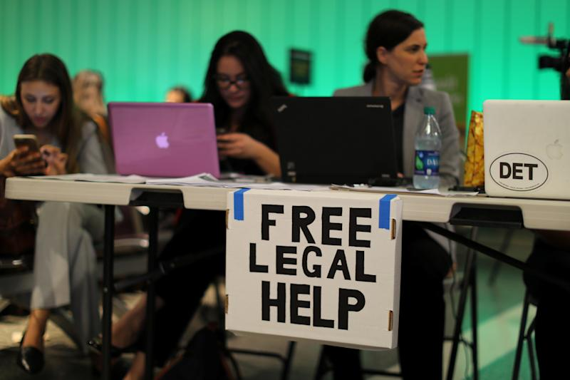 At Los Angeles International Airport on June 29, volunteer lawyers set up a table to help arriving passengers affected by Trump's executive order targeting travelers from six predominantly Muslim countries. (Mike Blake / Reuters)