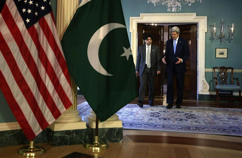 Secretary of State John Kerry (R) and Pakistani Minister of Interior Nisar Ali Khan in Washington on February 19, 2015