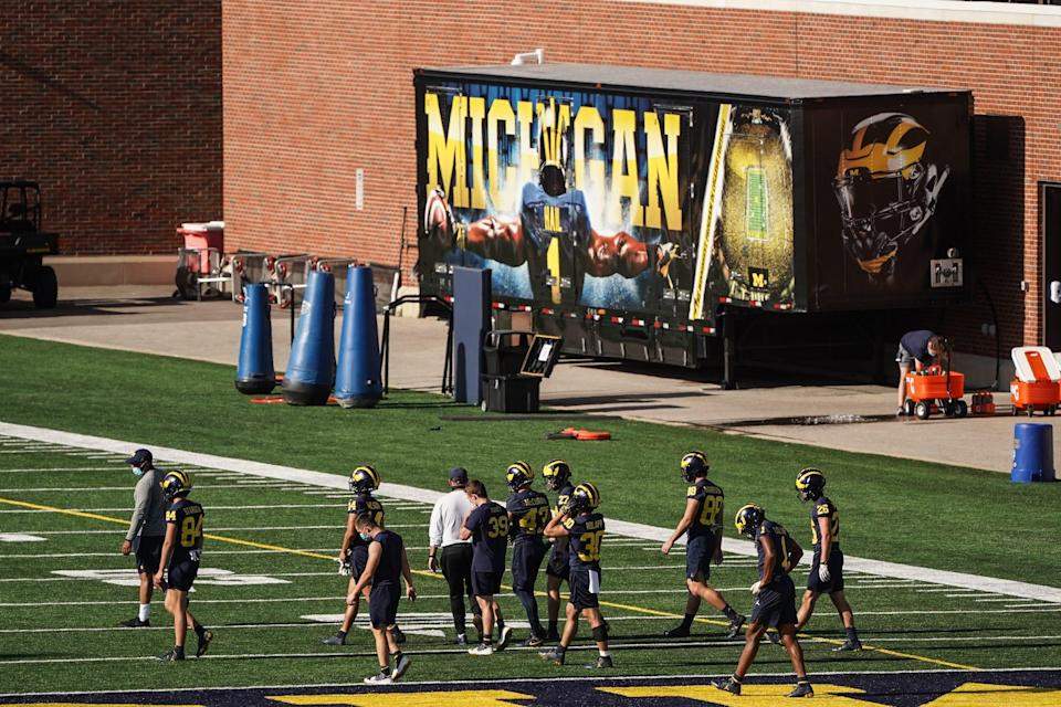 Michigan football players practice on campus in Ann Arbor, Tuesday, August 11, 2020 during a voluntary workout, following the cancellation of the Big Ten fall season.