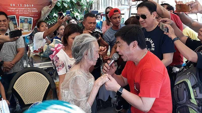 Centenarian gets P100K, hears songs from Ahong