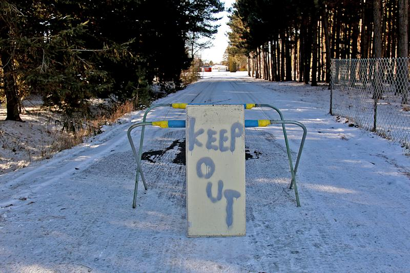 """A keep out sign stands at the property of Byron David Smith, in Little Falls, Minn., Monday, Nv. 26, 2012. Smith, a 64-year-old Minnesota homeowner who shot two teenagers in the midst of an apparent Thanksgiving Day break-in told authorities he feared they had a weapon, but acknowledged firing """"more shots than I needed to"""" and appeared to take pride in """"a good clean finishing shot"""" for one teen, according to investigators. He was charged Monday with two counts of second-degree murder. (AP Photo/The Star Tribune, Elizabeth Flores) MANDATORY CREDIT; ST. PAUL PIONEER PRESS OUT; MAGS OUT; TWIN CITIES TV OUT"""
