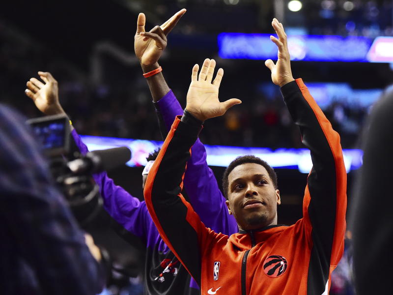 Toronto Raptors guard Kyle Lowry acknowledges the cheering crowd after he became the franchise leader in assists, during the second half of the team's NBA basketball game against the Atlanta Hawks on Tuesday, Jan. 28, 2020, in Toronto. (Frank Gunn/The Canadian Press via AP)