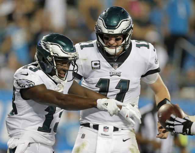 Philadelphia Eagles' Nelson Agholor (13) celebrates his touchdown catch against the Carolina Panthers with quarterback Carson Wentz (11). (AP)