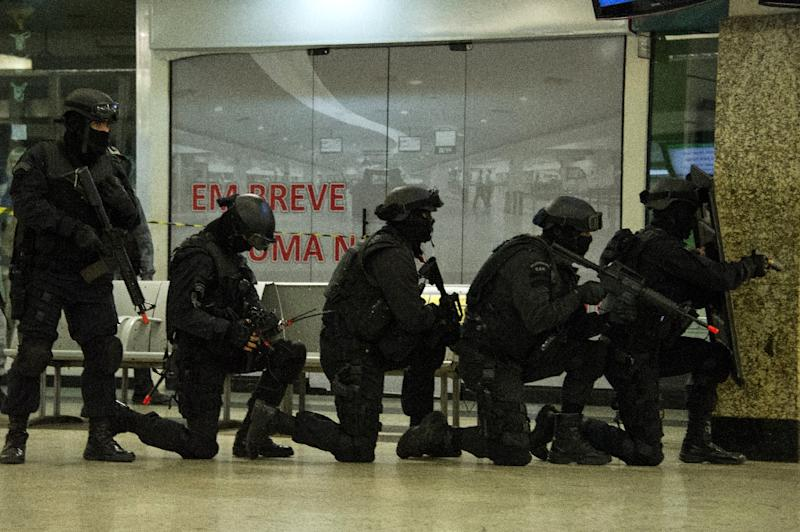 Members of various Brazilian police forces train during a hostage taking drill at the Central Bus station in Rio de Janeiro on early October 1, 2015