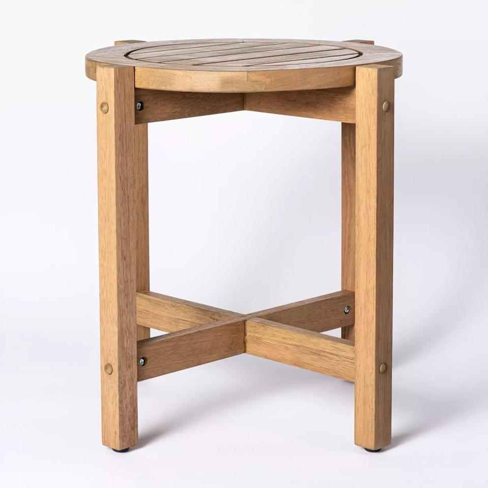 <p>The <span>Bluffdale Wood Patio Accent Table</span> ($100) is practically waiting for you to rest a drink on top. </p>