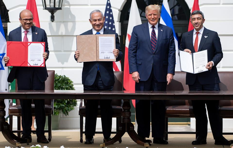 From left to right, Bahrain Foreign Minister Abdullatif al-Zayani, Israeli Prime Minister Benjamin Netanyahu, U.S. President Donald Trump and UAE Foreign Minister Abdullah bin Zayed Al Nahyan are pictured at the White House on Sept. 15, 2020, after signing the Abraham Accords, in which Bahrain and the United Arab Emirates recognized Israel. (Photo: SAUL LOEB via Getty Images)