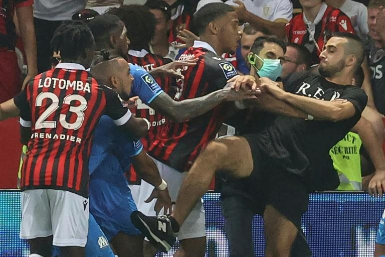 Dimitri Payet (2nd L) is involved in the melee that ensued after he was struck by a bottle thrown from the crowd