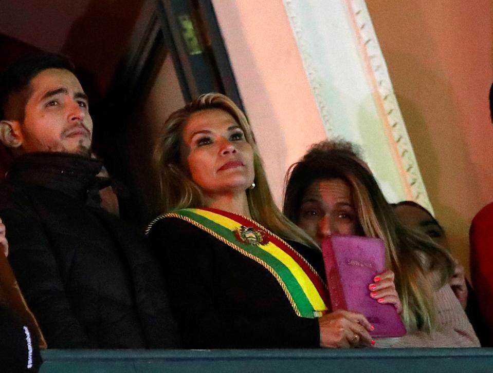 Bolivian Senator Jeanine Anez gestures after she declared herself as Interim President of Bolivia, at the balcony of the Presidential Palace, in La Paz, Bolivia November 12, 2019. REUTERS/Henry Romero