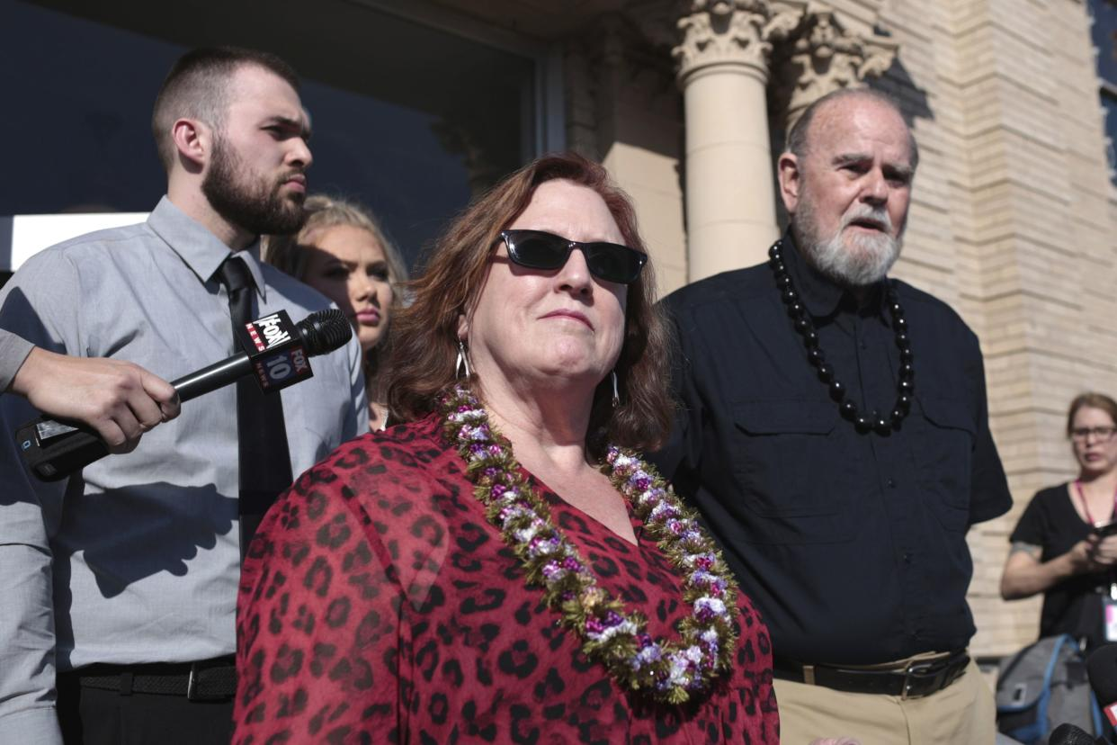 Kay Woodcock, center, and Larry Woodcock, right, address the media outside court at a hearing for Lori Vallow Daybell on Friday, March 6, 2020, in Rexburg, Idaho.
