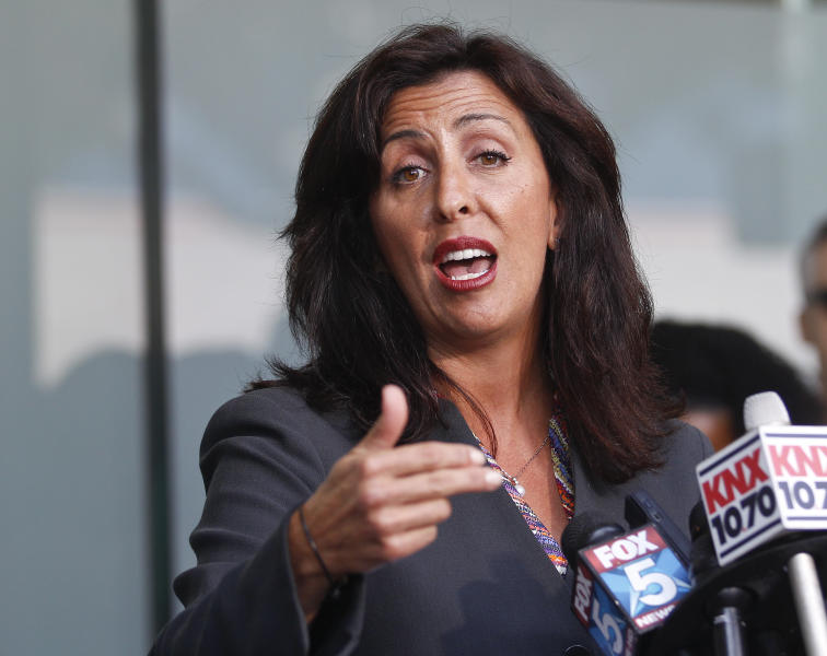 Lisa Damiani, an attorney and spokesperson for the parents of alleged Colorado mass murderer James Holmes, speaks at a news conference Monday, July 23, 2012 in San Diego. (AP Photo/Lenny Ignelzi)