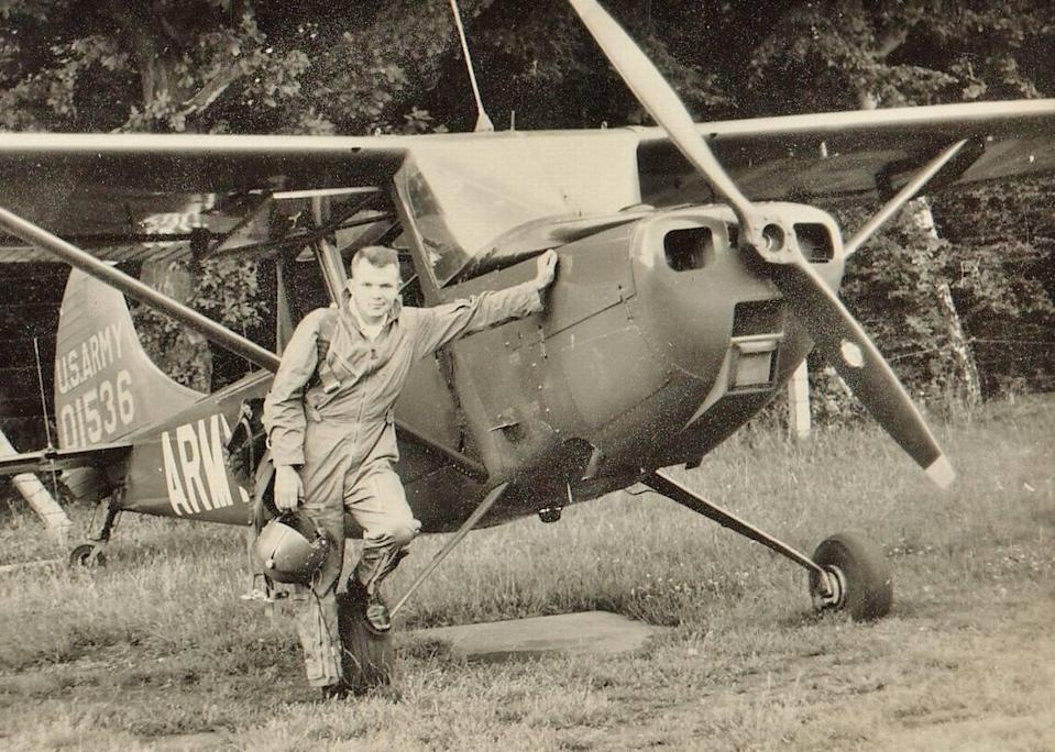 Jim Goetcheus stands in front of his plane in Germany, where he was stationed in the Army from 1960 to 1963. Goetcheus battled against a severe fear of heights to become a pilot in the military. He served as a career military officer for more than 20 years, including two tours in Vietnam where he earned a Purple Heart and a Bronze Star. He wanted to have a funeral at Arlington National Cemetery.