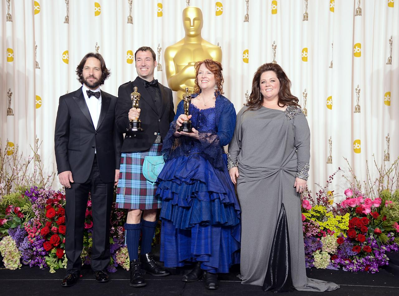 "HOLLYWOOD, CA - FEBRUARY 24:  Directors Mark Andrews (2nd L) and Brenda Chapman (2nd R), winners of the Best Animated Feature award for ""Brave,"" with presenters Paul Rudd (L) and Melissa McCarthy (R), pose in the press room during the Oscars held at Loews Hollywood Hotel on February 24, 2013 in Hollywood, California.  (Photo by Jason Merritt/Getty Images)"