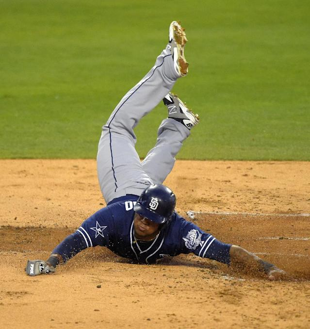San Diego Padres' Rymer Liriano scores on a fielding error by Los Angeles Dodgers' Scott Van Slyke during the second inning of a baseball game, Wednesday, Aug. 20, 2014, in Los Angeles. (AP Photo/Mark J. Terrill)