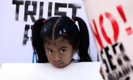 A young pro-immigration protester in Los Angeles on June 26: Republicans may need to soften their stance on immigration if they want to woo Latinos in future elections.