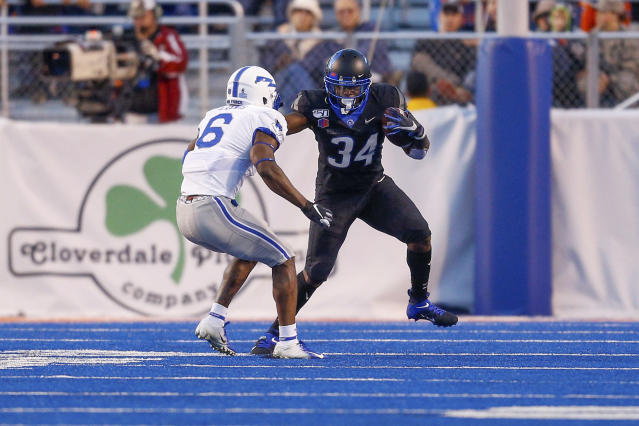 Boise State running back Robert Mahone (34) runs at Air Force defensive back Zane Lewis (6) with the ball in the first half of an NCAA college football game, Friday, Sept. 20, 2019, in Boise, Idaho. (AP Photo/Steve Conner)