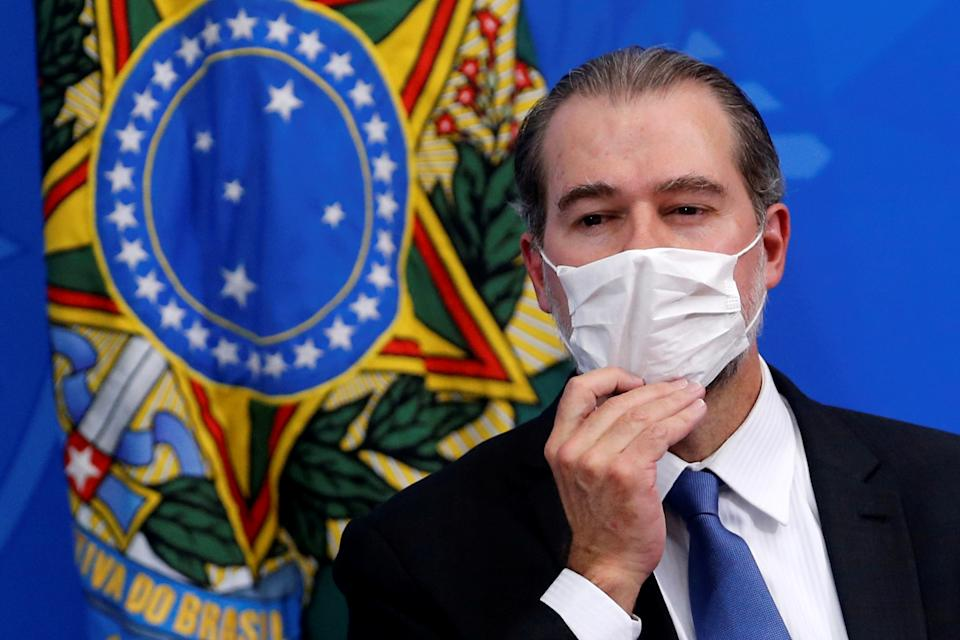 President of Brazil's Supreme Federal Court Dias Toffoli adjusts his protective face mask during a press statement to announce federal judiciary measures to curb the spread of the coronavirus disease (COVID-19) in Brasilia, Brazil March 18, 2020. REUTERS/Adriano Machado
