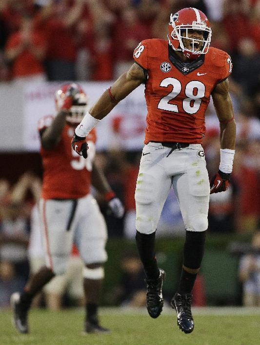 Georgia safety Tray Matthews (28) celebrates after their 44-41 win over LSU in an NCAA football game, Saturday, Sept. 28, 2013, in Athens, Ga. (AP Photo/John Bazemore)