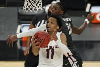 Arizona State's Alonzo Verge Jr. (11) shoots around Washington State's Noah Williams (24) during the second half of an NCAA college basketball game in the first round of the Pac-12 men's tournament Wednesday, March 10, 2021, in Las Vegas. (AP Photo/John Locher)