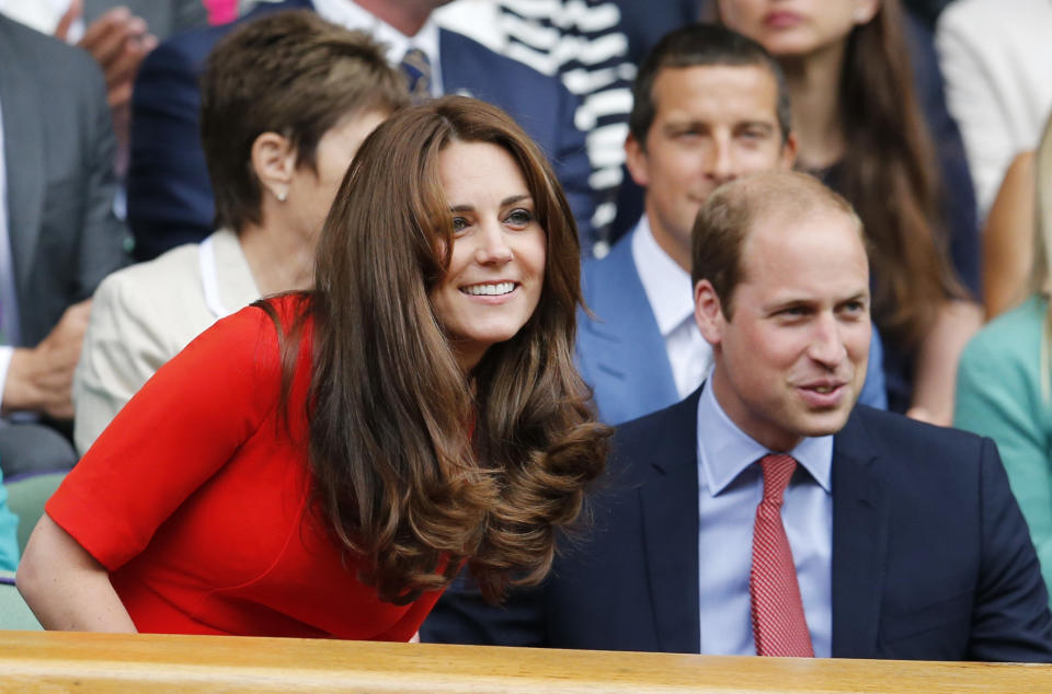 Britain's Catherine Duchess of Cambridge and Prince William (R) in the royal box on Centre Court at the Wimbledon Tennis Championships in London, July 8, 2015.                           REUTERS/Suzanne Plunkett