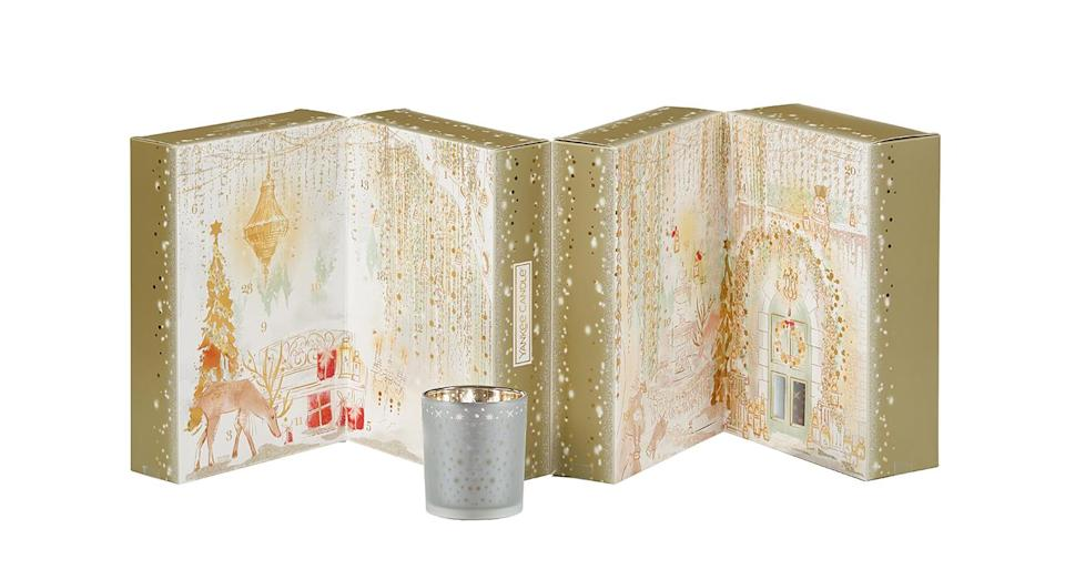 """<p>If you love nothing more than staying in with a scented candle for company, this is the calendar for you. Each door reveals a different treat; either a tea light, votive or votive holder. <a rel=""""nofollow noopener"""" href=""""https://www.amazon.co.uk/Yankee-Candle-Holiday-Sparkle-Calendar/dp/B07GX326VW"""" target=""""_blank"""" data-ylk=""""slk:Available from Amazon."""" class=""""link rapid-noclick-resp""""><em>Available from Amazon.</em></a> </p>"""