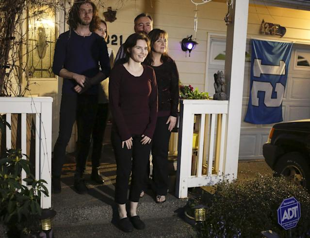 Amanda Knox talks to the press surrounded by family outside her mother's home in Seattle, Washington March 27, 2015. Italy's top court on Friday annulled the conviction of American Amanda Knox for the 2007 murder of British student Meredith Kercher and, in a surprise verdict, acquitted her of the charge. The Court of Cassation threw out the second guilty verdict to have been passed on Knox, 27, and her Italian former boyfriend Raffaele Sollecito for the lethal stabbing. REUTERS/Jason Redmond