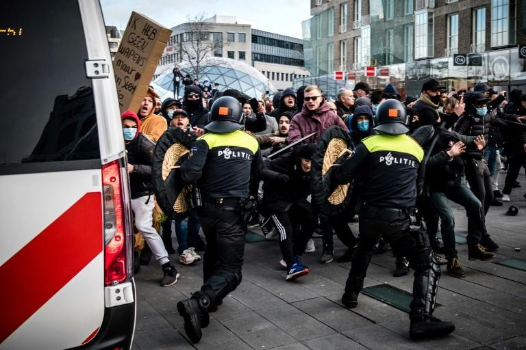 People in the Dutch city of Eindhoven burned cars and looted businesses during an anti-curfew demonstration