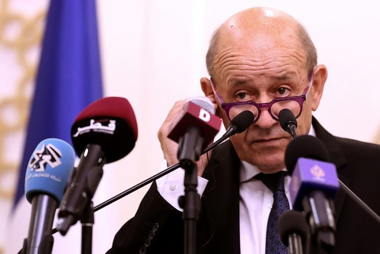 French Foreign Minister Jean-Yves Le Drian, who has voiced anger over Australia's scrapping of a submarine deal, speaks in Doha on September 13, 2021 (AFP/KARIM JAAFAR)
