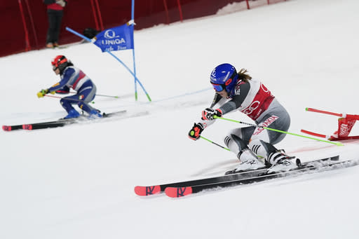 Slovakia's Petra Vlhova, right, and Italy's Federica Brignone speed down the course during an alpine ski women's World Cup parallel giant slalom in Lech/Zuers, Austria, Thursday, Nov. 26, 2020. (AP Photo/Giovanni Auletta)