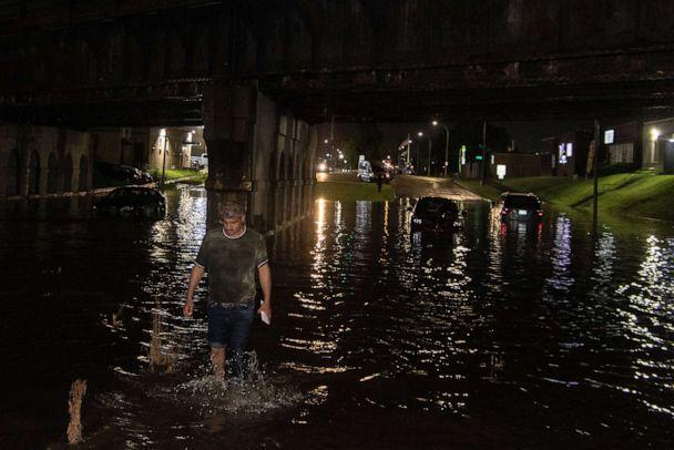 PHOTO: A severe thunderstorm hit Dearborn, Mich., causing significant flooding on Ford Road and other streets where some motorists who braved the waters were forced to abandon their vehicles, July 24, 2021. (Adam J. Dewey/NurPhoto via Shutterstock)