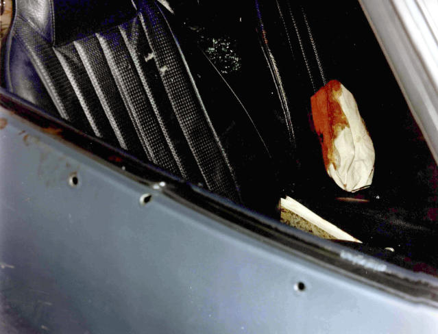 "This undated photo released by the U.S. Attorney's Office and presented as evidence Wednesday, June 19, 2013, during the trial of James ""Whitey"" Bulger in U.S. District Court in Boston, shows a car with bullet holes in the door and a bloody cap on the seat. Bulger, the reputed former head of the mostly Irish-American Winter Hill Gang based in South Boston, is accused of playing a role in 19 killings during the 1970s and '80s. (AP PhotoU.S. Attorney's Office)"