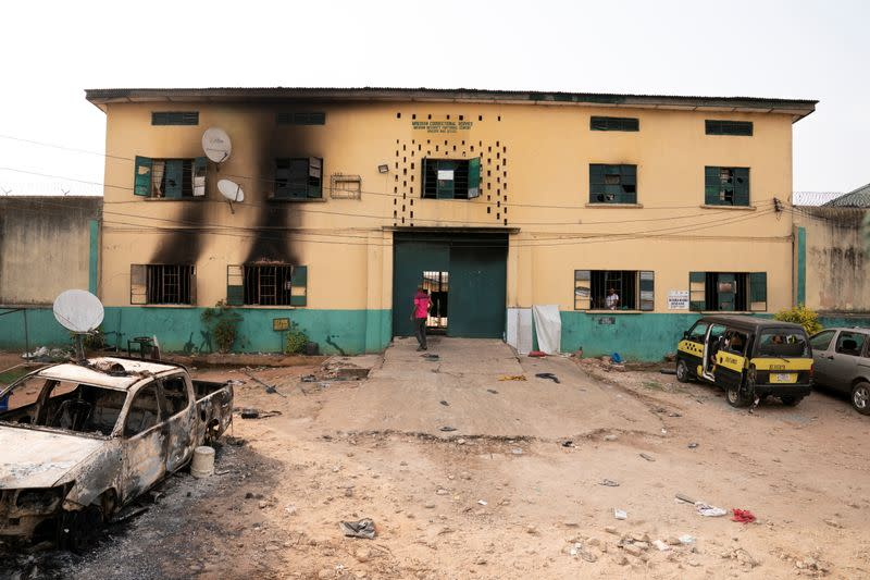 A man is seen standing in front of the main gate of the Nigerian Correctional Services facility that was attacked by gunmen, with large numbers of inmates set freed afterwards in Imo State