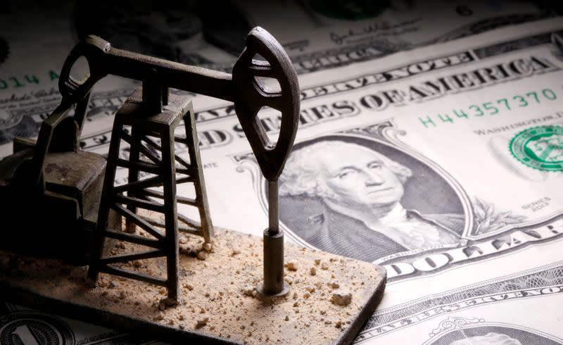 FILE PHOTO: A 3D printed oil pump jack is placed on dollar banknotes in this illustration picture