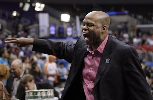 Oregon State head coach Craig Robinson celebrates his team's 86-84 win against Washington in an NCAA college basketball game at the Pac-12 conference championship in Los Angeles, Thursday, March 8, 2012. (AP Photo/Jae C. Hong)