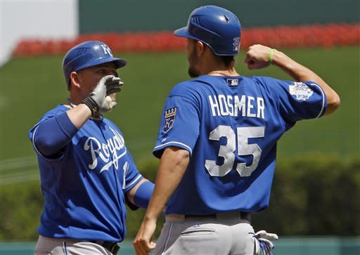 Kansas City Royals Billy Butler, left, and Eric Hosmer celebrate Butler's first inning home run against the Los Angeles Angels in a baseball game at Anaheim, Calif., Sunday, April 8, 2012. Hosmer answered with his own two-run homer in the fifth as the Royals won, 7-3. (AP Photo/Reed Saxon)