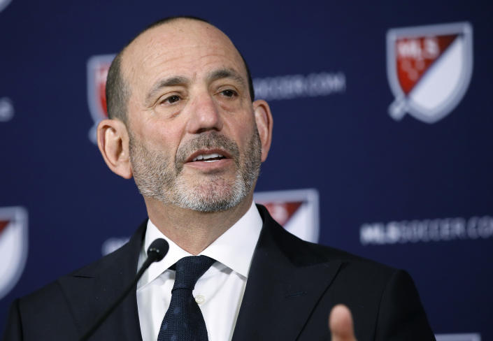 FILE - In this April 18, 2019 file photo Major League Soccer Commissioner Don Garber speaks at a news conference in Los Angeles. Garber's 20th anniversary as Major League Soccer's commissioner is Sunday, Aug. 4, 2019 and the league's challenge these days is growth and not survival, an upward trajectory that will be boosted when the U.S. co-hosts the World Cup in 2026. MLS has doubled in size to 24 teams under Garber's leadership, plays primarily in soccer specific stadiums and maintains an average attendance among the top 10 soccer leagues in the world. (AP Photo/Alex Gallardo, file)