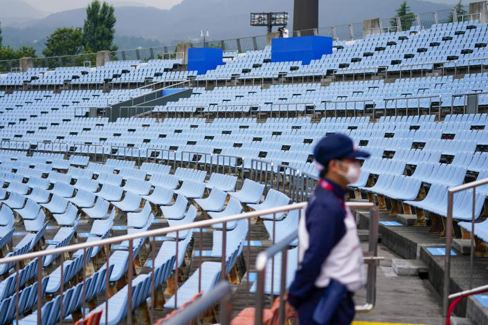 FILE - In this July 22, 2021, file photo, a steward stands in the empty stands at the softball game between the Mexico and Japan at the 2020 Summer Olympics in Fukushima , Japan. (AP Photo/Jae C. Hong, File)