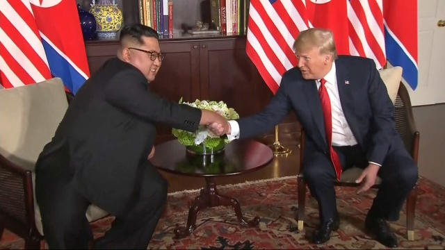 <p>In this image made from video provided by Host Broadcaster Mediacorp Pte Ltd,, U.S. President Donald Trump and North Korean leader Kim Jong Un shake hands ahead of their meeting at Capella Hotel in Singapore, Tuesday, June 12, 2018. (Host Broadcaster Mediacorp Pte Ltd via AP) </p>