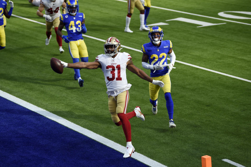 San Francisco 49ers running back Raheem Mostert scores a rushing touchdown against the Los Angeles Rams. (AP Photo/Kelvin Kuo)