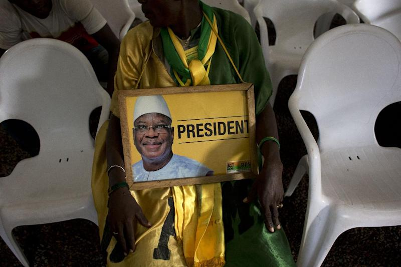 A disappointed supporter of Ibrahim Boubacar Keita sits in an emptying viewing tent, after watching the televised reading of election results at Keita campaign headquarters in Bamako, Mali,Friday, Aug. 2, 2013. Mali's presidential race will go to a second round on Aug. 11. Keita finished with a strong lead over his next closest rival, Soumaila Cisse, but still well shy of the majority needed to win outright in the first round.(AP Photo/Rebecca Blackwell)