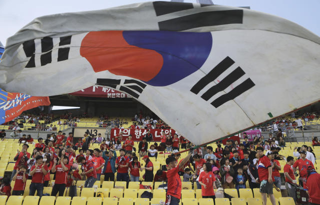 A South Korean soccer fan waves a huge national flag prior to the start of the international friendly soccer match between South Korea and Honduras, in Daegu, South Korea, Monday, May 28, 2018. (AP Photo/Lee Jin-man)