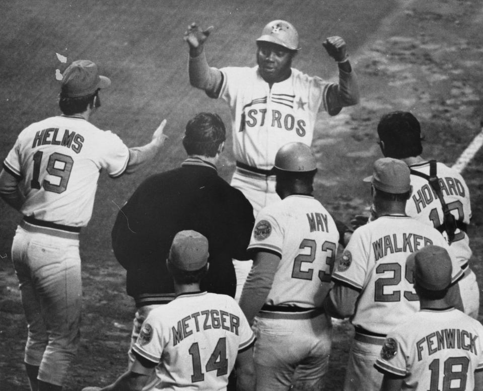 """FILE - In this 1972 file photo, Houston Astros' Jimmy Wynn, top, is greeted at the plate after a home run in a baseball game in Houston. Wynn, the slugger who earned his nickname of """"The Toy Cannon"""" during his days with the Astros in the 1960s and '70s, has died. Wynn was 78. The Astros said he died on Thursday, March 26, 2020, in Houston, but did not provide further details. (Blair Pittman/Houston Chronicle via AP)"""