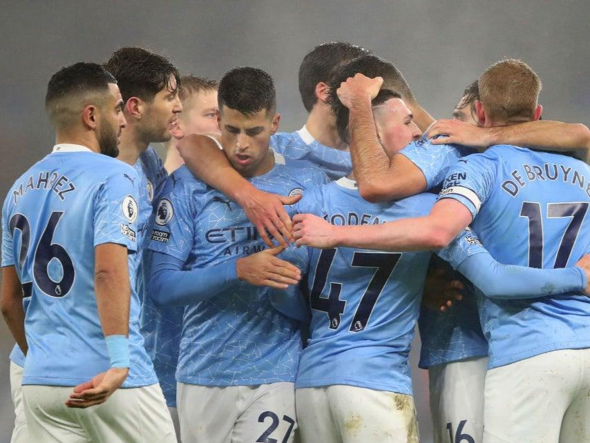 Man City celebrate Phil Foden's goalGetty Images