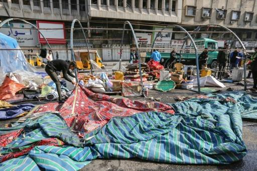 Demonstrators in Baghdad's Tahrir (Liberation) Square dismantle their long-running protest camp