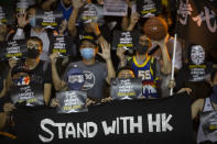 FILE - In this file photo taken Oct. 15, 2019, demonstrators hold up signs in support of Houston Rockets general manager Daryl Morey during a rally at the Southorn Playground in Hong Kong. CCTV announced Friday, Oct. 9, 2020 that it would air Game 5 of the NBA Finals between the Los Angeles Lakers and Miami Heat the first time that the league would appear on the network since the rift that started when Morey tweeted support for anti-government protesters in Hong Kong. (AP Photo/Mark Schiefelbein, File)