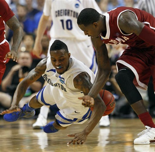 Creighton's Josh Jones goes to the floor as he battles for the ball with Alabama's JaMychal Green, right, A during the second half of a Midwest Regional NCAA tournament second-round college basketball game in Greensboro, N.C., Friday, March 16, 2012. Creighton won 58-57. (AP Photo/Gerry Broome)