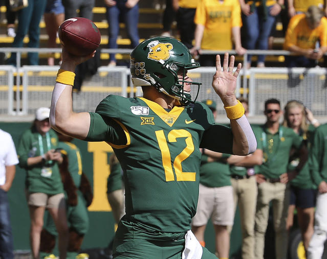 Baylor quarterback Charlie Brewer (12) drops back to pass against Texas Tech during the first half of a NCAA college football game in Waco, Tex.,Saturday, Oct. 12, 2019.(AP Photo/Jerry Larson)