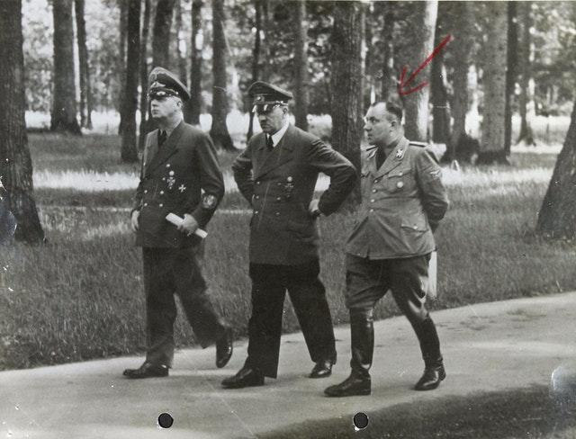 Adolf Hitler flanked by Joachim von Ribbentrop and Martin Bormann (National Archives/PA)