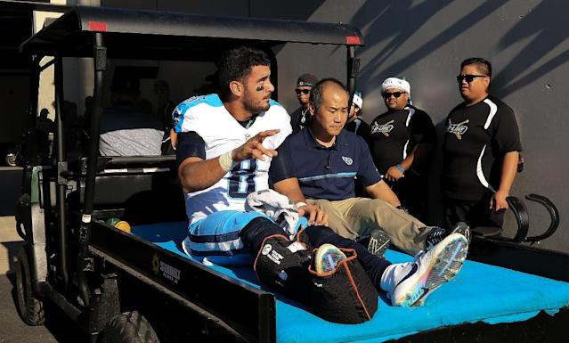 Marcus Mariota of the Tennessee Titans waves as he is carted off the field after fracturing his leg during the second half of the game against the Jacksonville Jaguars December 24, 2016 in Jacksonville, Florida (AFP Photo/Rob Foldy)