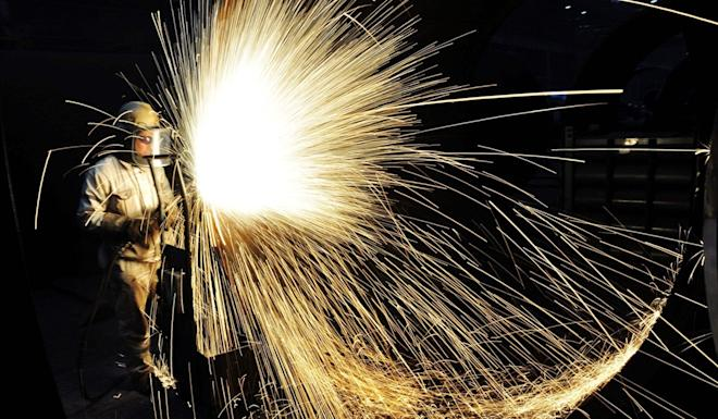 A Chinese worker cutting steel in Qingdao in China's eastern Shandong province. Photo: AFP