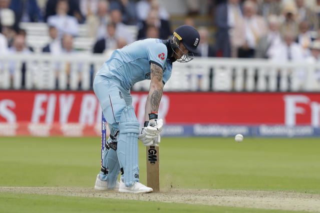 England's Ben Stokes is bowled out by a yorker from Australia's Mitchell Starc during the Cricket World Cup match between England and Australia at Lord's cricket ground in London, Tuesday, June 25, 2019. (AP Photo/Matt Dunham)
